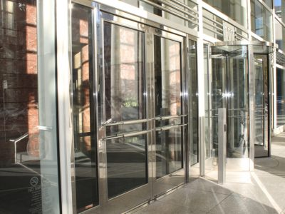 skyscraper revolving glass doors - Glass Front Cafe 2015